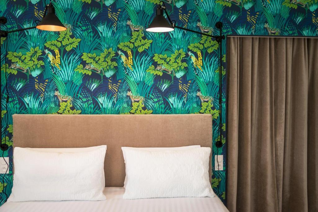 Un ou plusieurs lits dans un hébergement de l'établissement Hotel Edouard VII