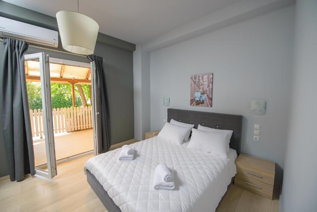 Prytanio tesisinde bir odada yatak veya yataklar