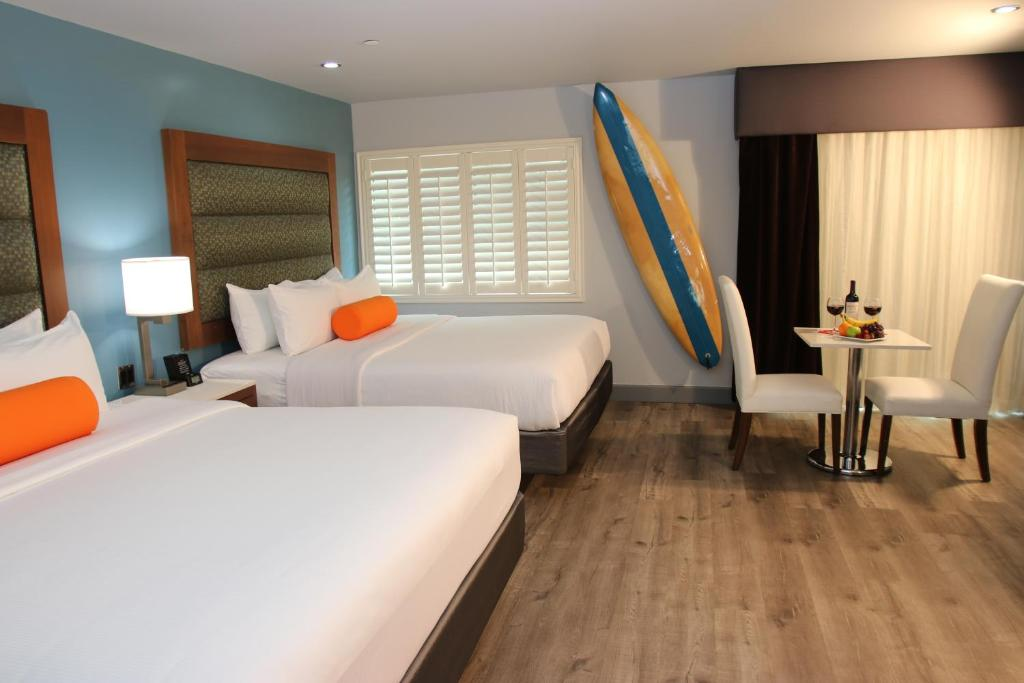 Ein Bett oder Betten in einem Zimmer der Unterkunft BLVD Hotel & Spa - Walking Distance to Universal Studios Hollywood