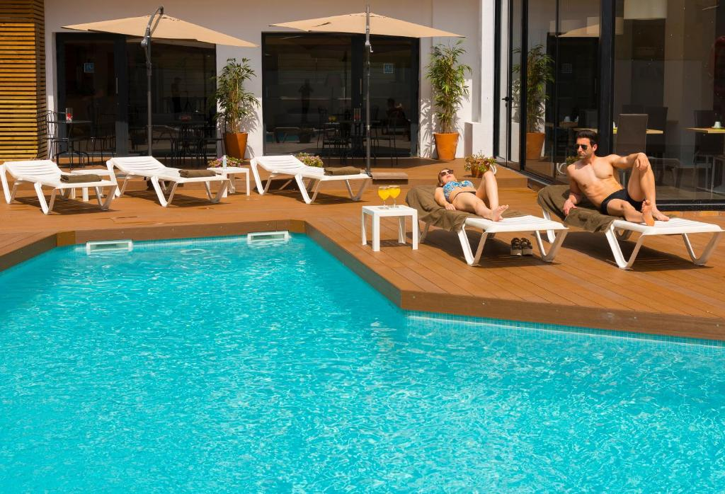 The swimming pool at or near Hotel Lauria