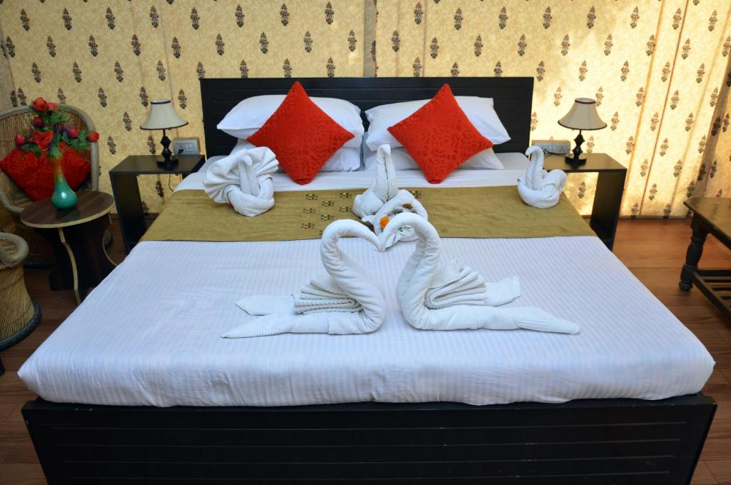 A bed or beds in a room at The Paramount Resort Pushkar