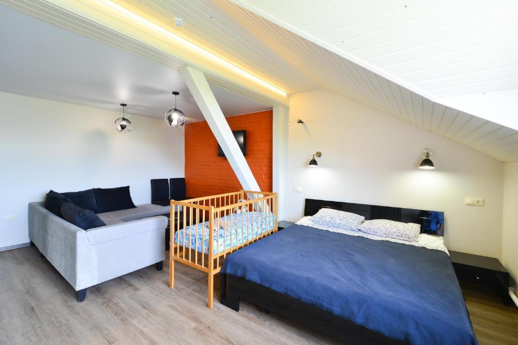 Кровать или кровати в номере Мини-отель ГОСТИ