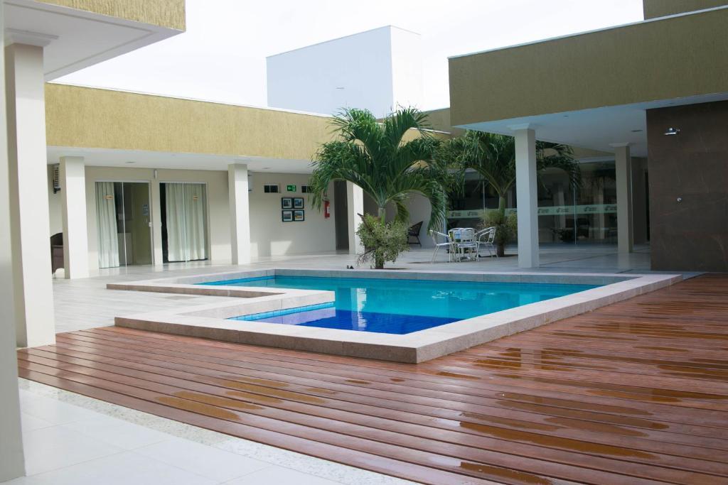 A piscina localizada em Pousada Rio Mar ou nos arredores