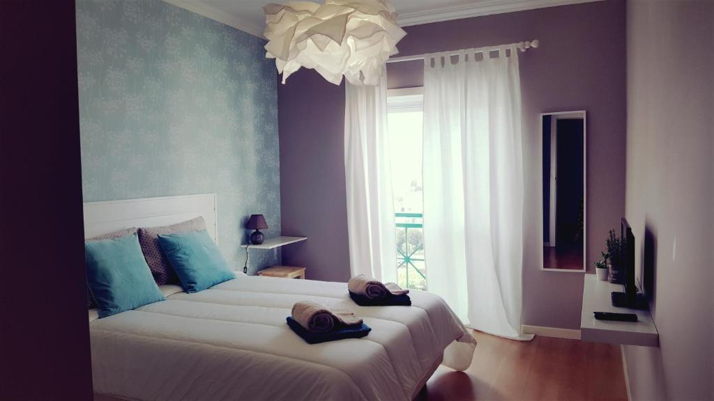 A bed or beds in a room at Casamar