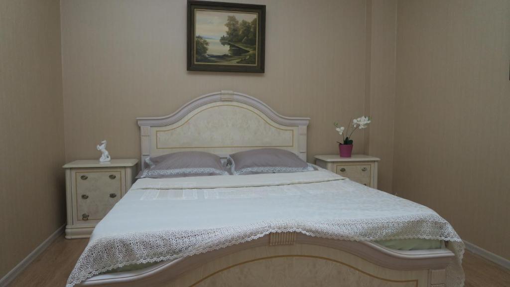 Кровать или кровати в номере Apartments on Krasnaya