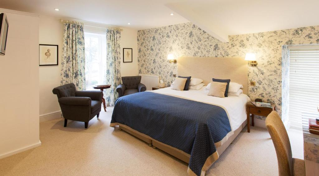 A bed or beds in a room at The Grasmere Hotel