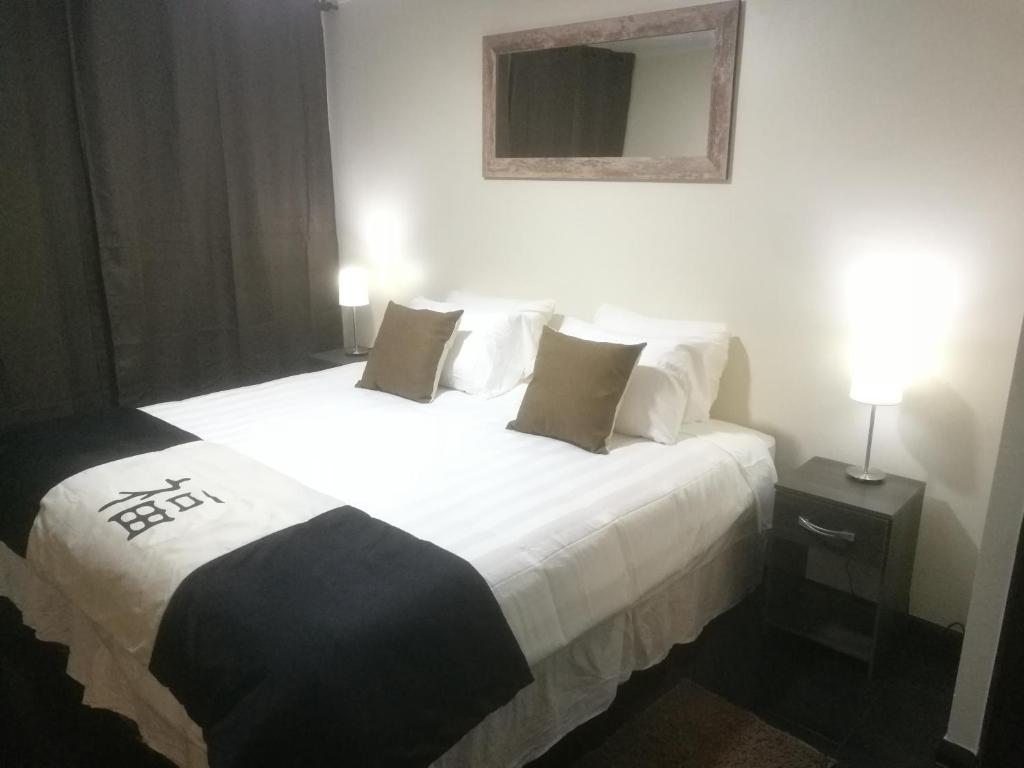 Cama o camas de una habitación en Apartamentos Santiago Centro R&M