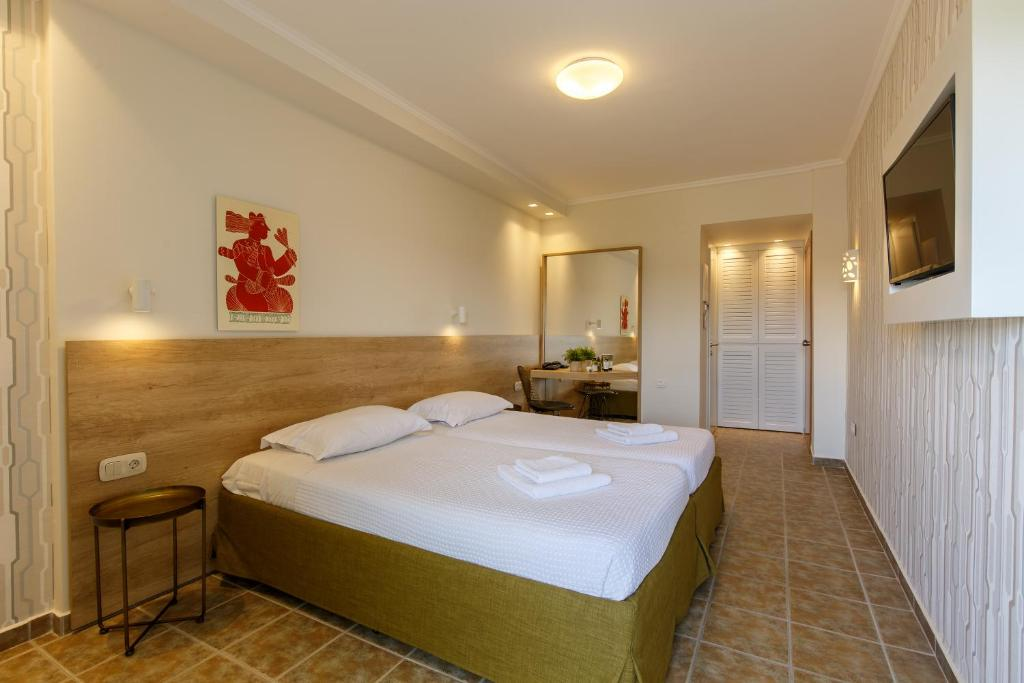 A bed or beds in a room at Marialena