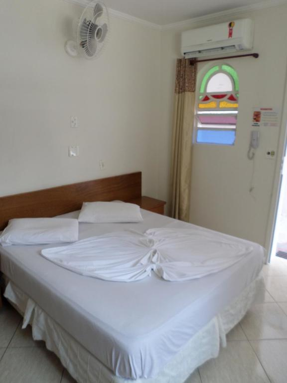 A bed or beds in a room at Canto do Casarão