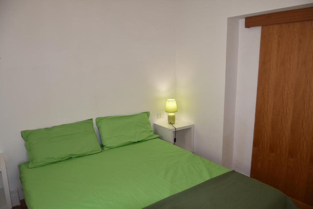 Letto o letti in una camera di Case Vacanza Verde e Lilla