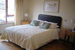 A bed or beds in a room at College View Apartments