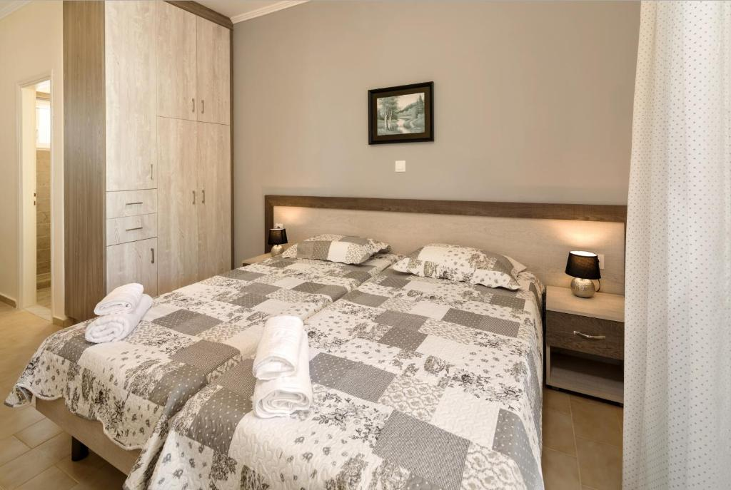 A bed or beds in a room at Morfeas Zante Apartments