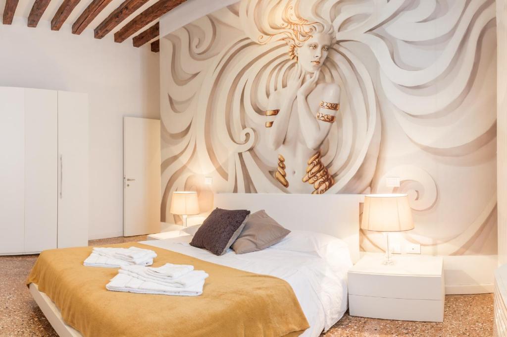 Letto o letti in una camera di Rialto Project Apartments