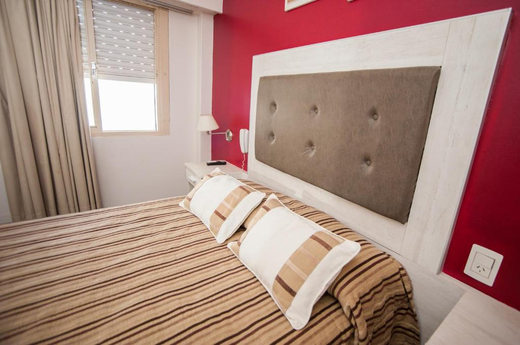 A bed or beds in a room at Hotel Posadas