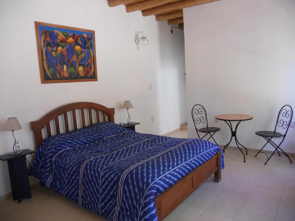 A bed or beds in a room at La Casa de Feli