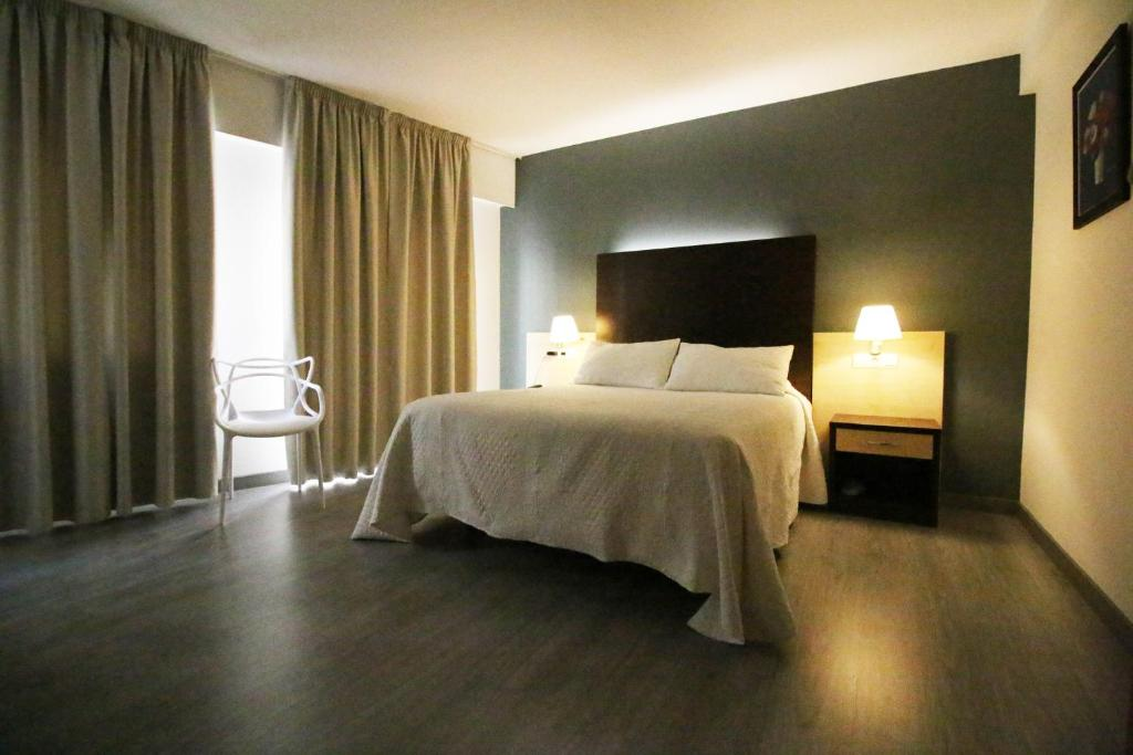 A bed or beds in a room at Nest Style Santiago