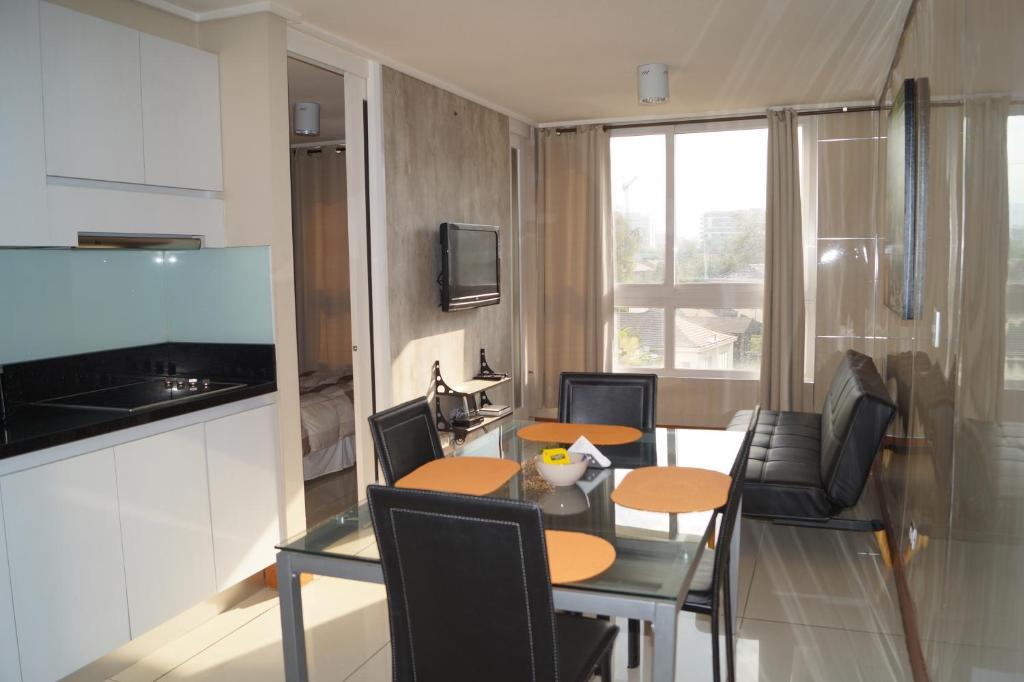 Una cocina o zona de cocina en JT Departamentos Amoblados Las Condes