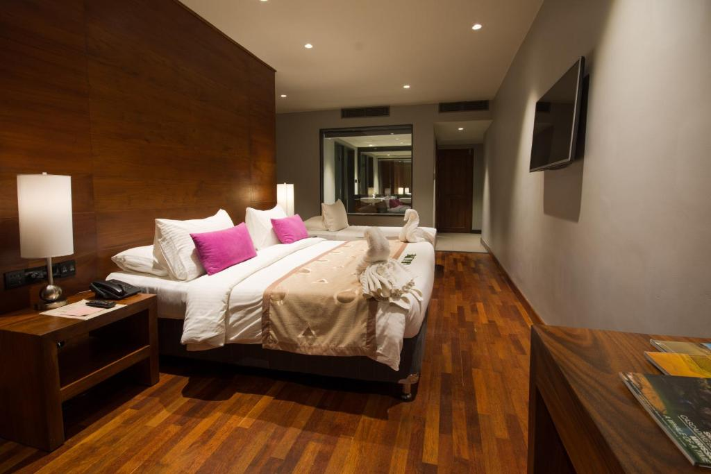 A bed or beds in a room at Swiss Residence Kandy