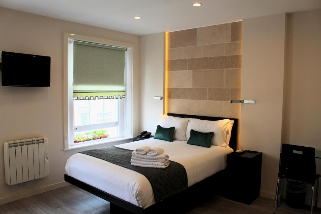 A bed or beds in a room at O Paddington