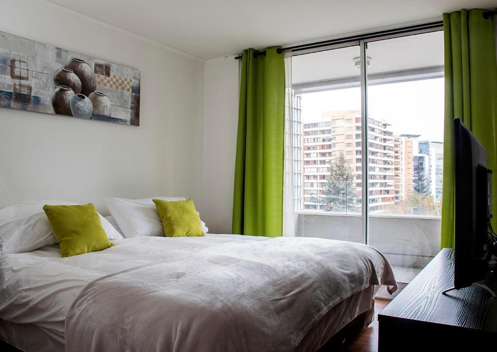 Cama o camas de una habitación en Kennedy Apartments Los Militares