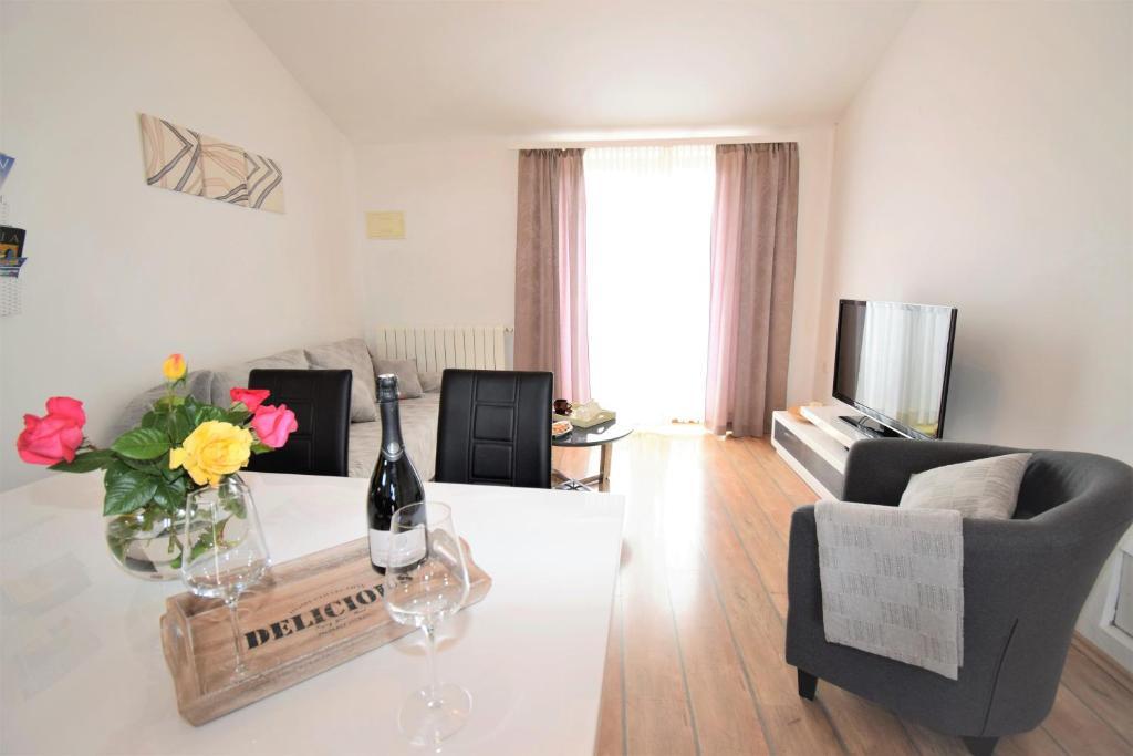 Ein Sitzbereich in der Unterkunft Apartment Vita