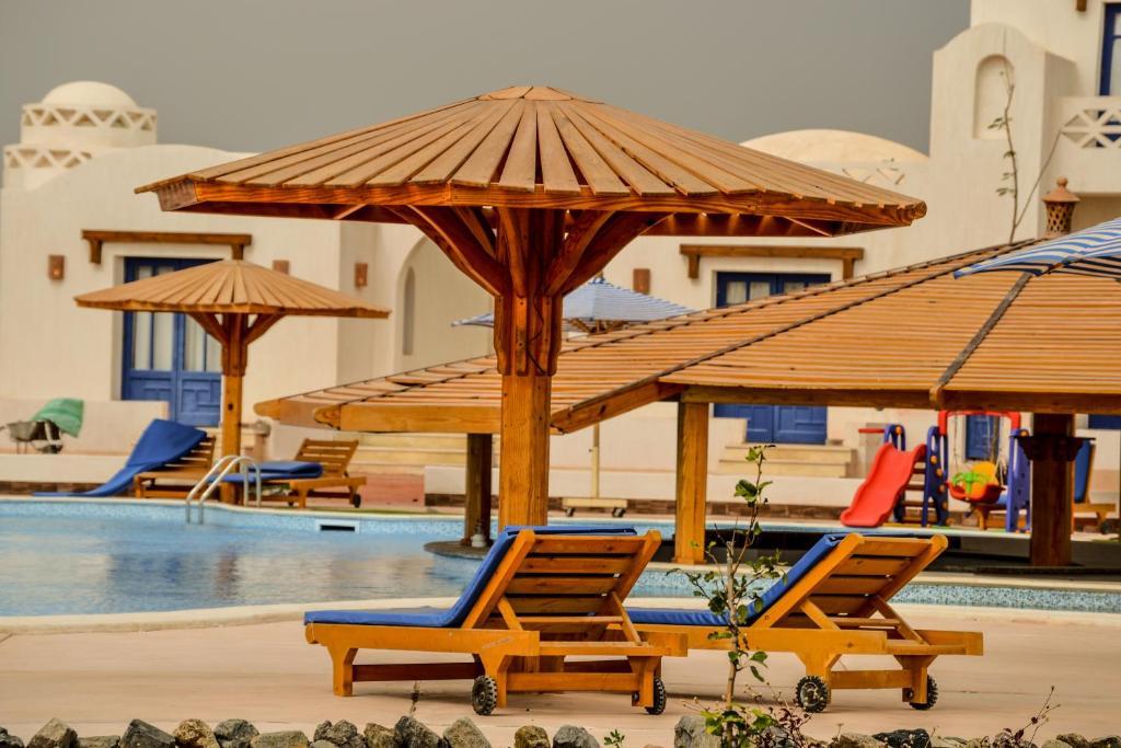 Het zwembad bij of vlak bij Aurora Beach Safari Resort