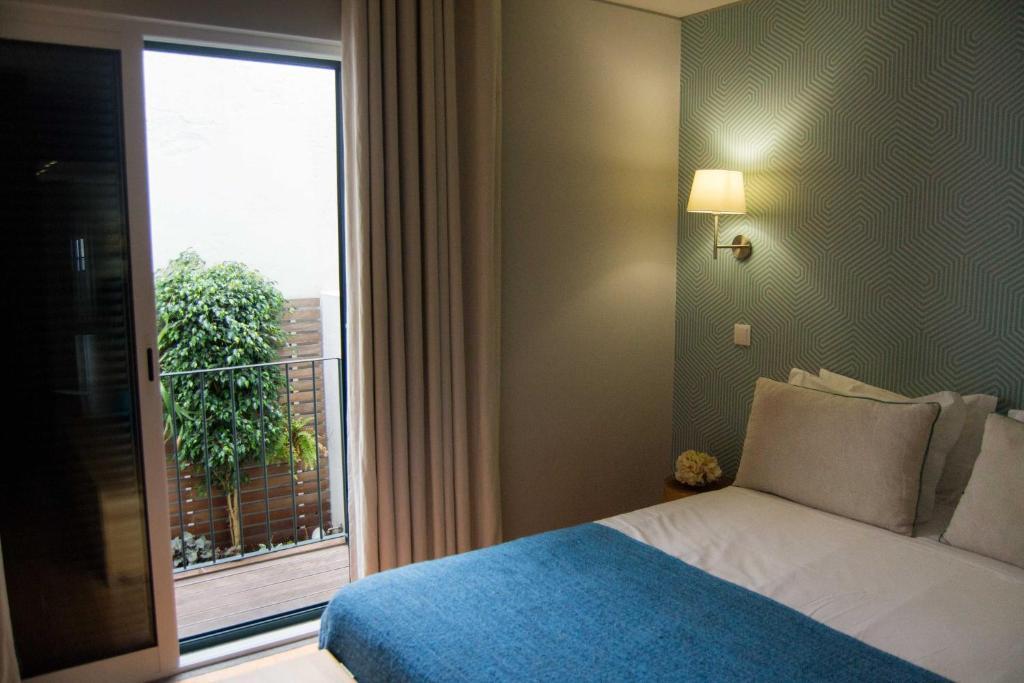 Uma cama ou camas num quarto em Apartamentos Santa Maria
