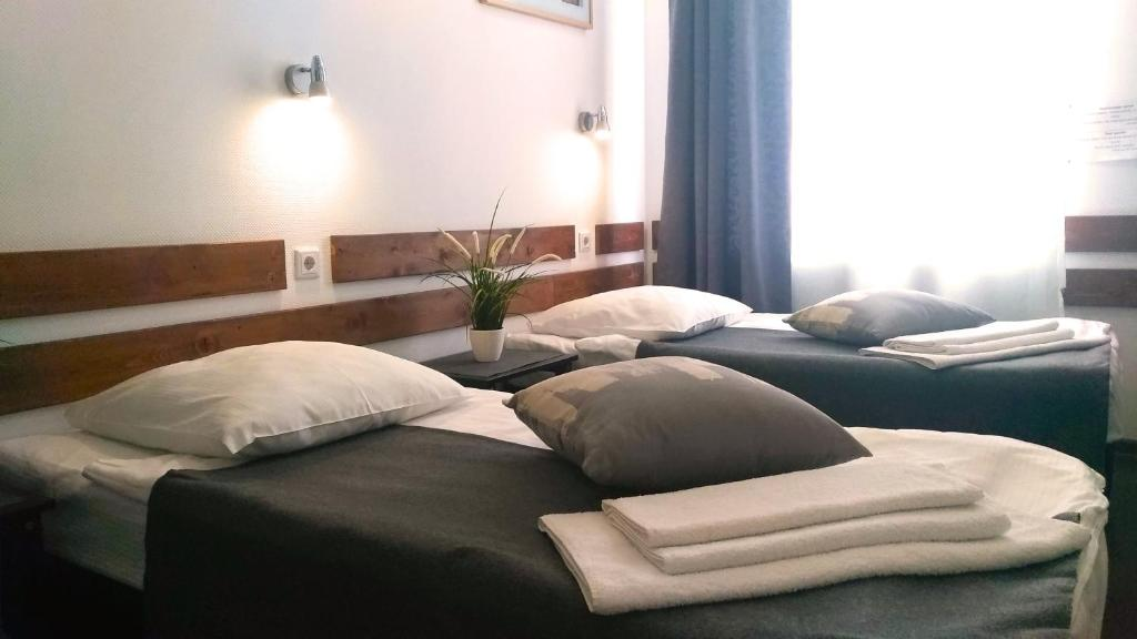 A bed or beds in a room at PEOPLE Business Novinsky Hotel
