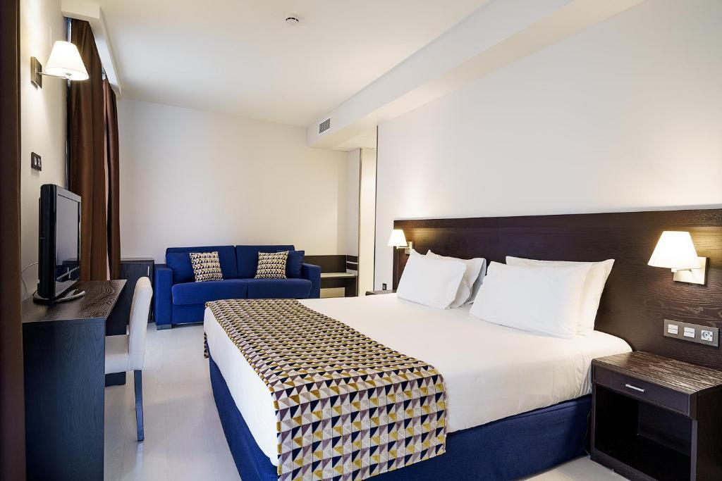 Cama o camas de una habitación en Exe Málaga Museos