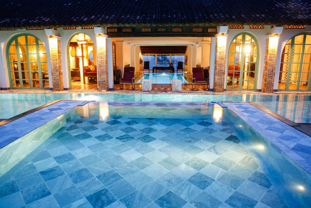 The swimming pool at or close to Villa Louise Hue Beach Boutique Hotel