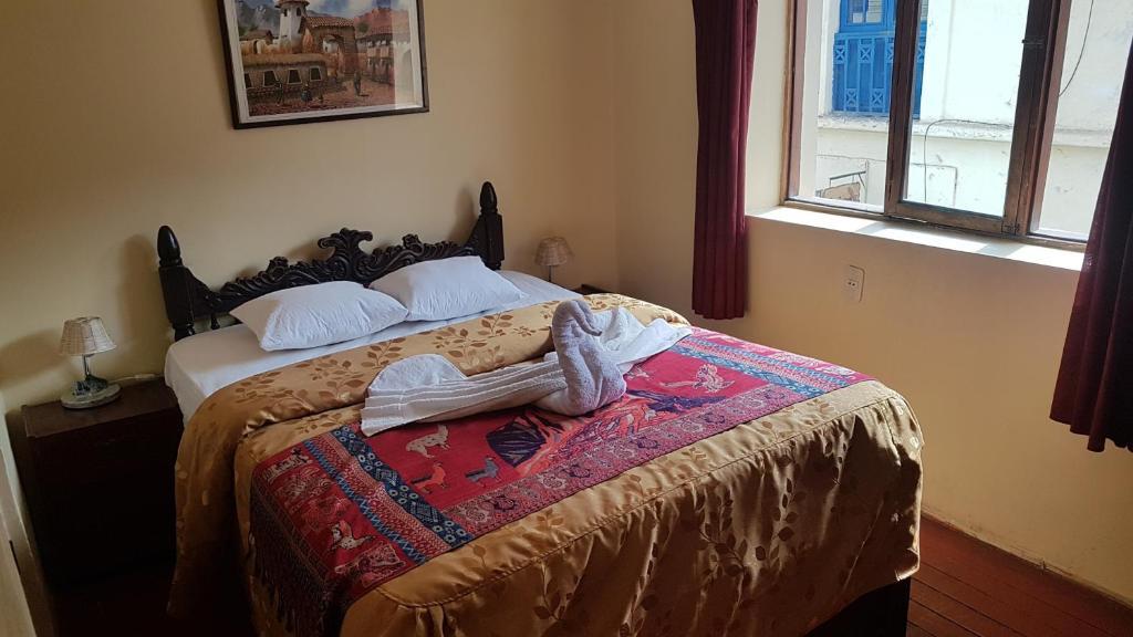 Cama o camas de una habitación en Hatun Rumi Hostal