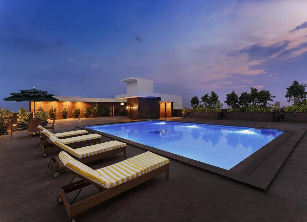 The swimming pool at or near LA Marvella A Sarovar Premiere Hotel