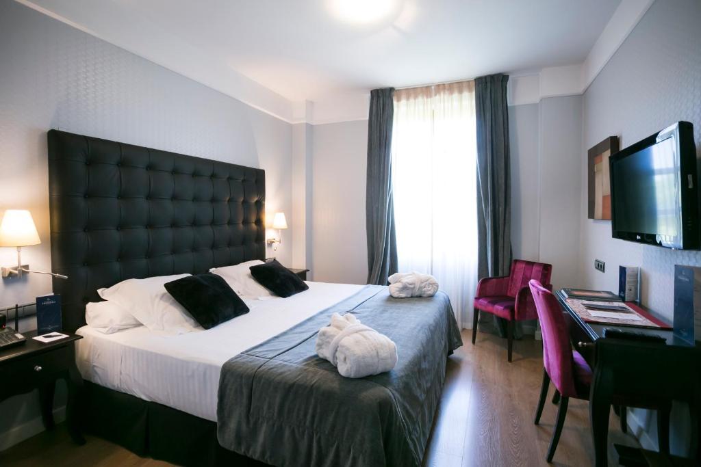 Cama o camas de una habitación en La Casa de la Trinidad