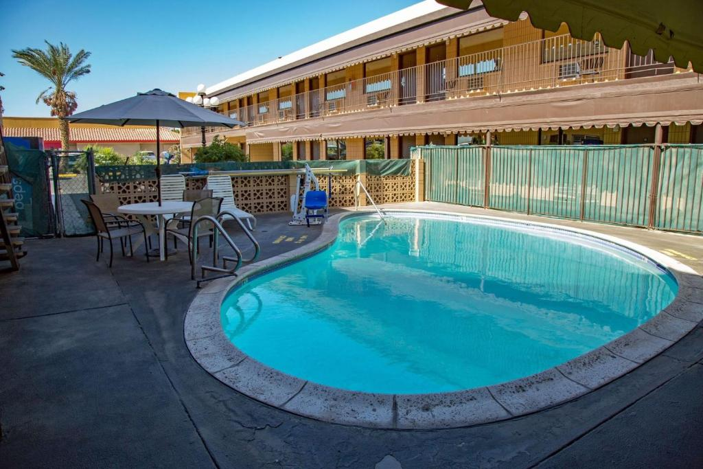The swimming pool at or near Townhouse Inn and Suites