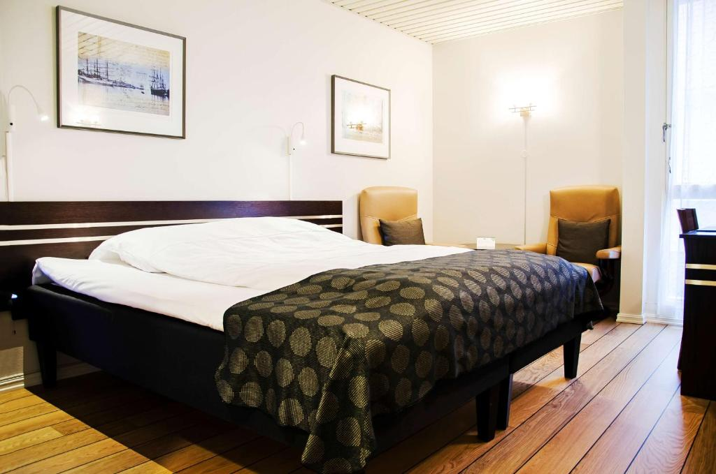 A bed or beds in a room at Best Western Havly Hotell