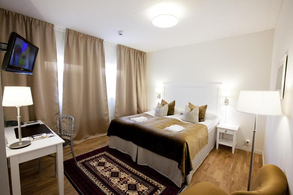 A bed or beds in a room at Best Western Gustaf Wasa Hotel