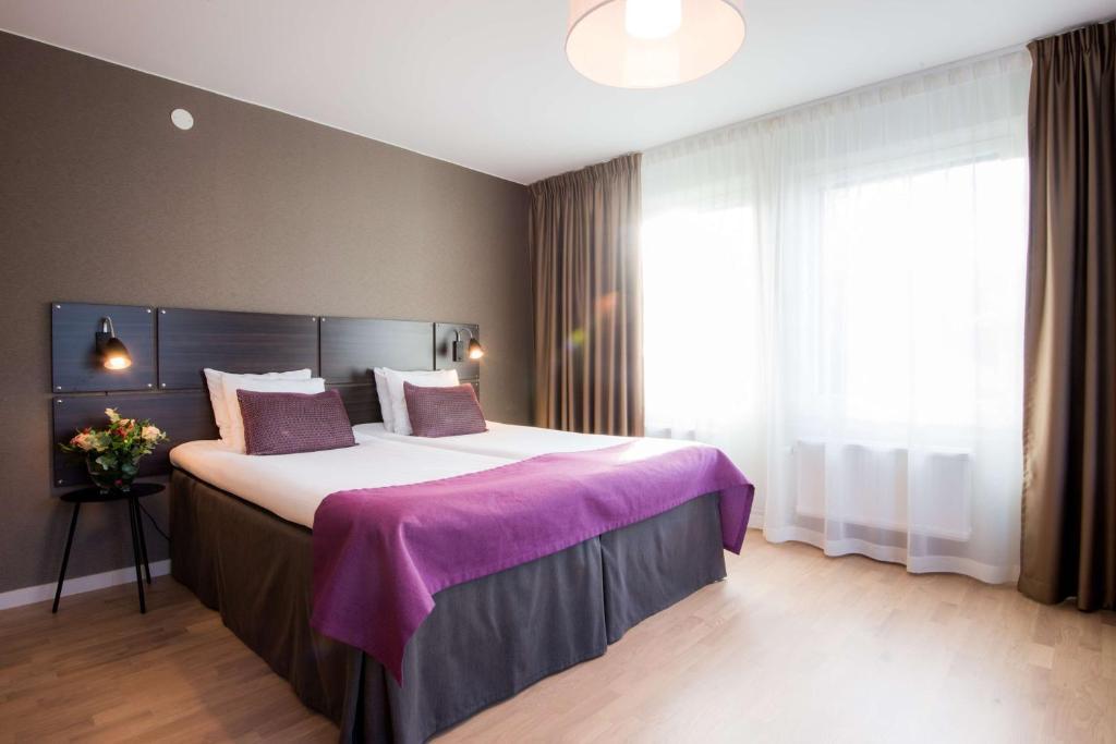 Lova arba lovos apgyvendinimo įstaigoje Best Western Plus Park Airport Hotel