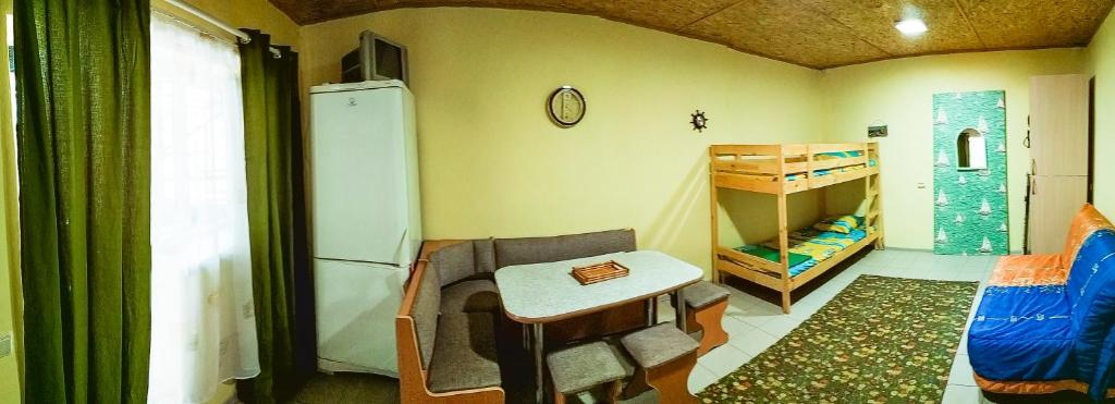 A seating area at Guest house Baza otdyha Vodnik
