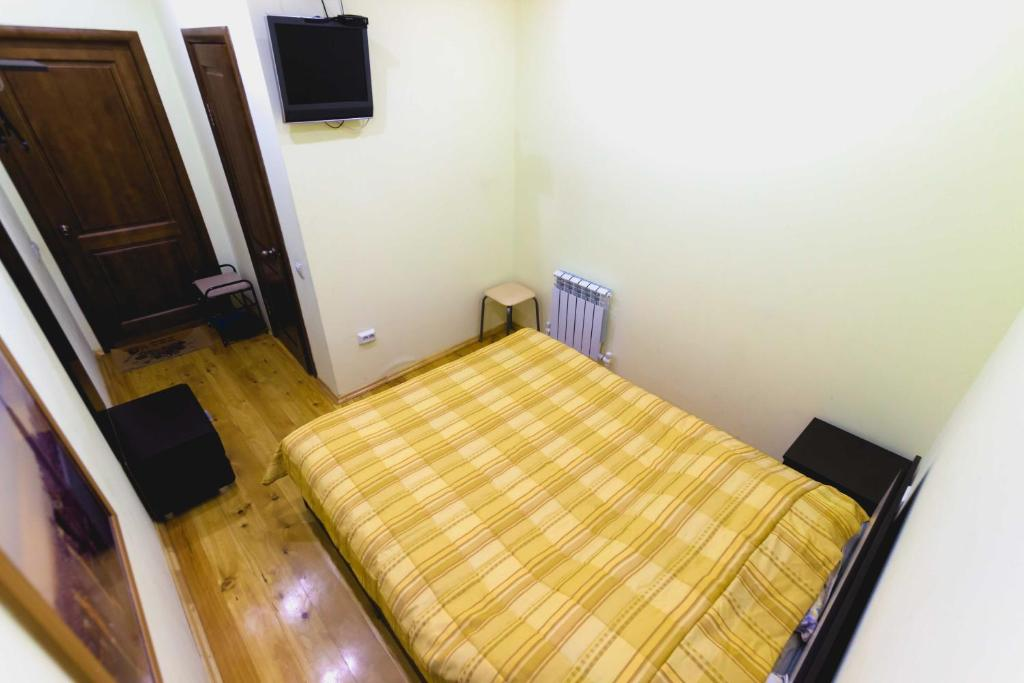 A bed or beds in a room at Hostel U City