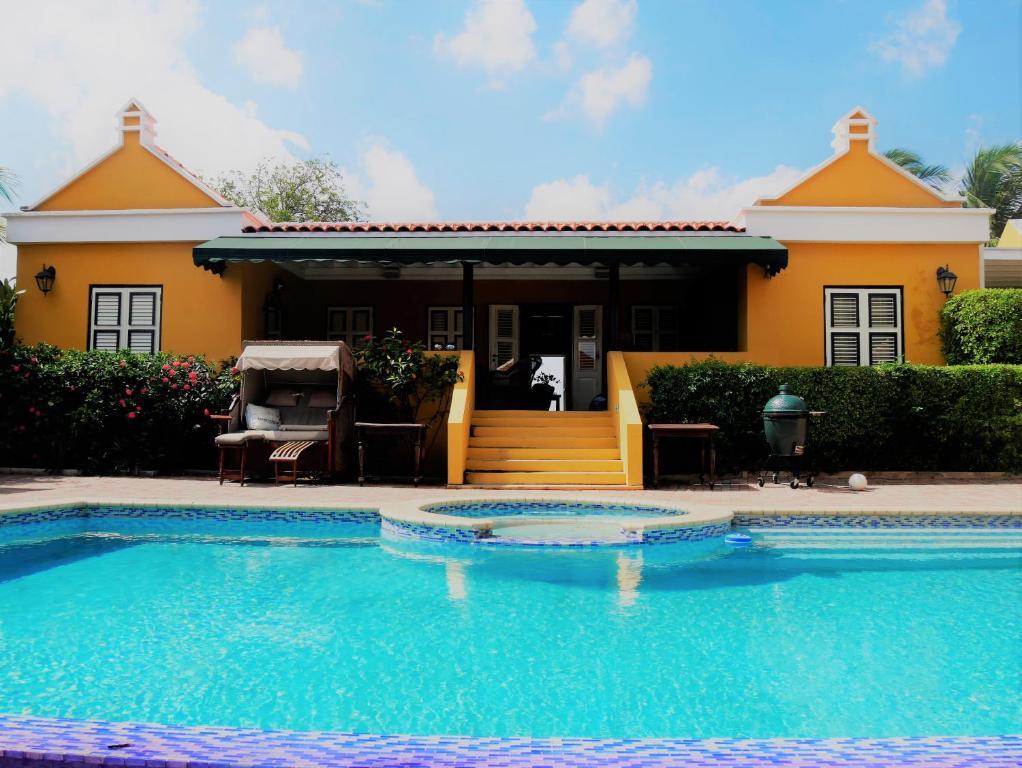 The swimming pool at or near Landhuis Bona Vista