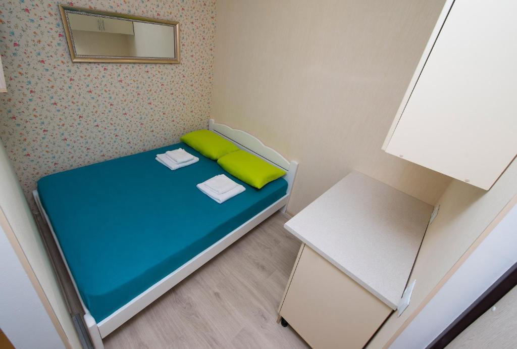 Кровать или кровати в номере Отель Паровоз