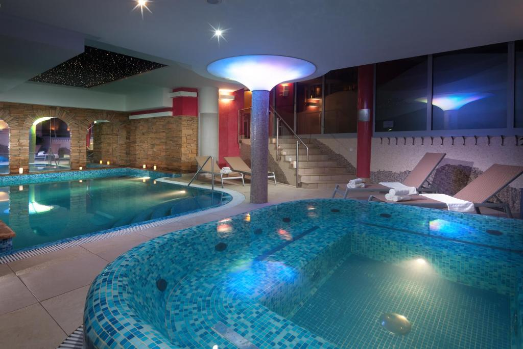 The swimming pool at or near Wellness Hotel Windsor
