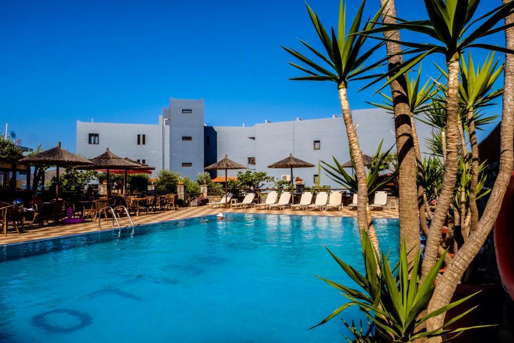 The swimming pool at or near Corali Studios & Portobello Apartments