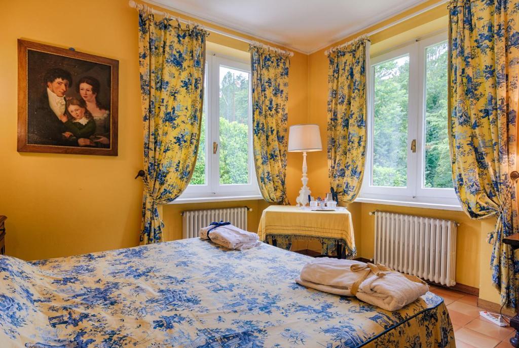 A bed or beds in a room at La Casanova