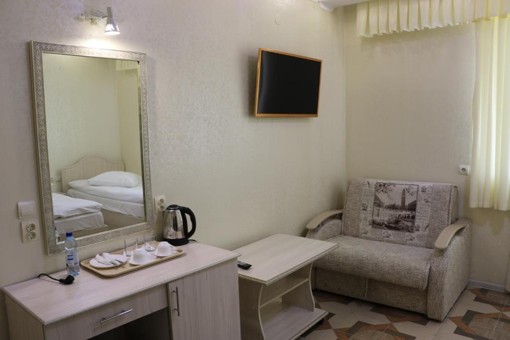Двухместный номер с 2 отдельными кроватями и дополнительной кроватью: фотография номер 3