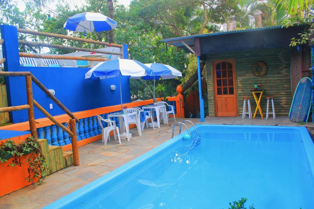 The swimming pool at or near Canto das Laranjeiras Tombo
