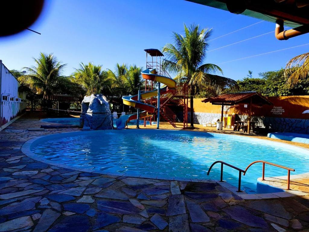 The swimming pool at or near Eco Pousada Novilha de Ouro