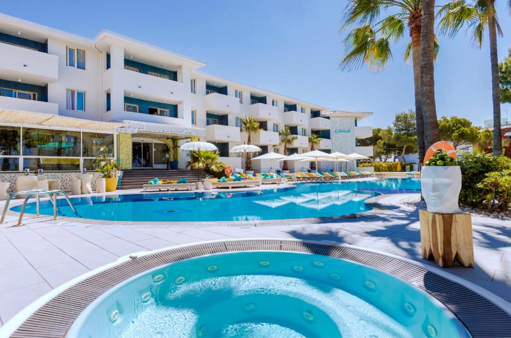 The swimming pool at or near Apartamentos Sotavento - Adults Only