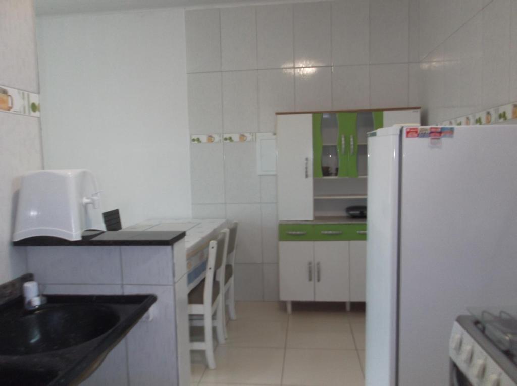 Una cocina o zona de cocina en apt. residen. atalaia sul