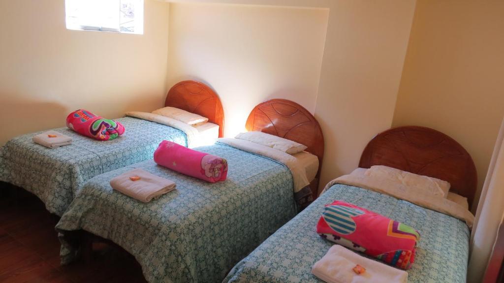 Cama o camas de una habitación en Hostal Samani